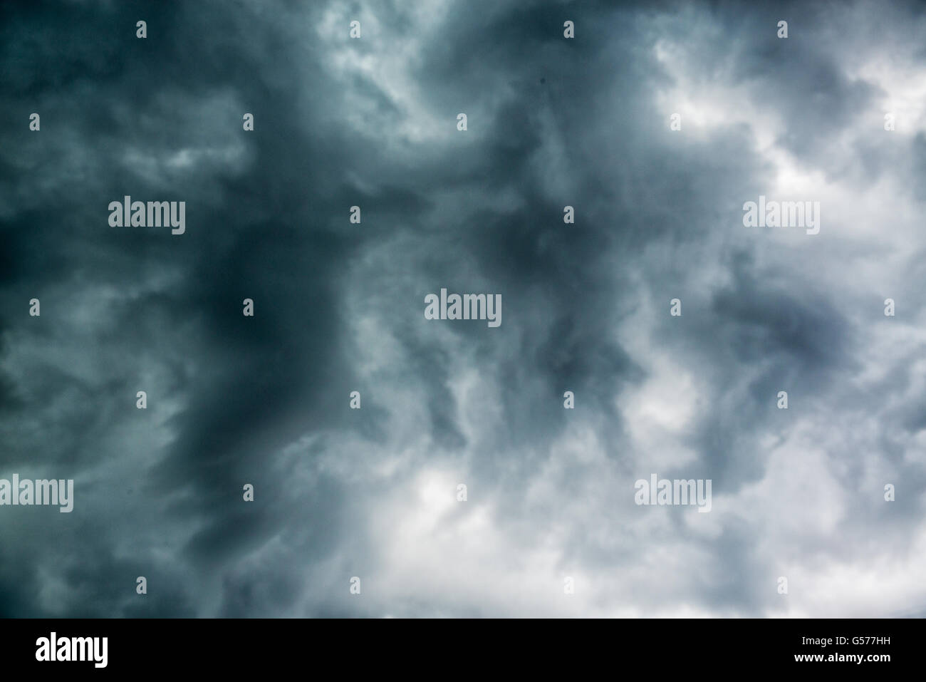 Black gloomy clouds sky - Stock Image