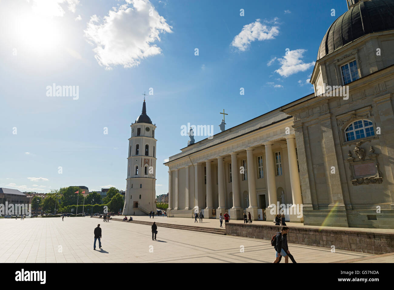 VILNIUS, LITHUANIA - JUNE 8, 2016: People at the Cathedral Square near the Cathedral of Vilnius. backlighting - Stock Image