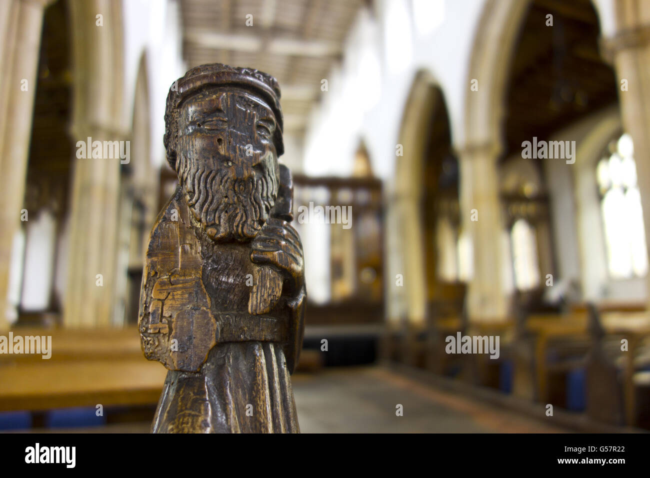 carved pew end Blythburgh Church - Stock Image
