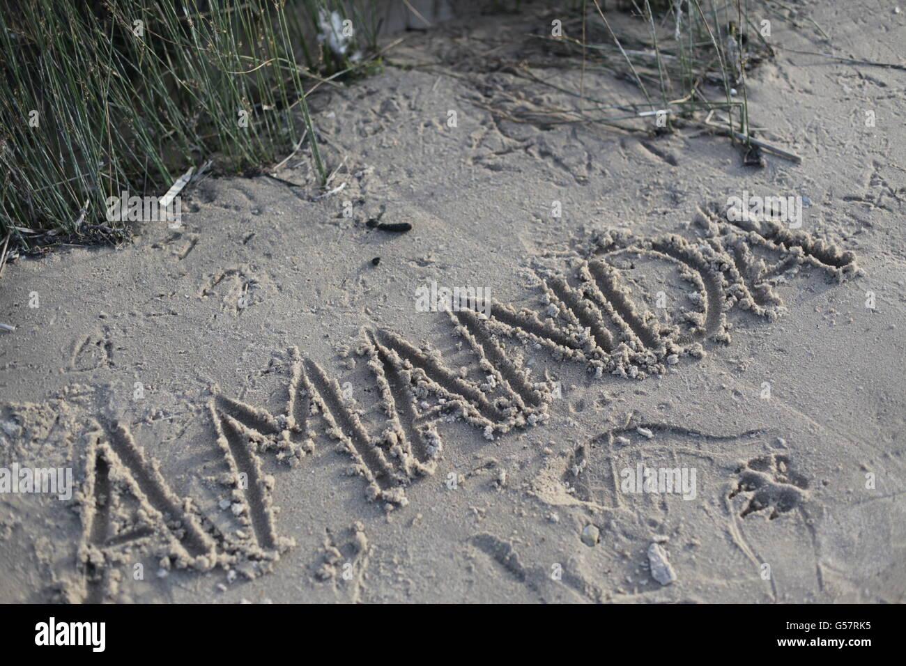 name amanda written in sand on beach - Stock Image
