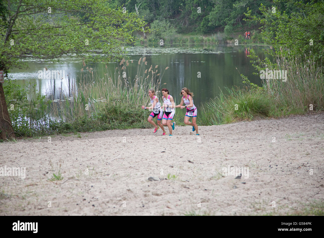 Team of women runners competing in Triathlon of Mimizam France - Stock Image