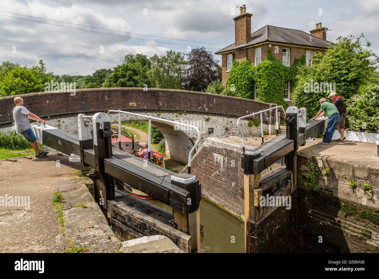 Closing the lock gates at Stockers Lock on the Grand Union Canal London England UK - Stock Image