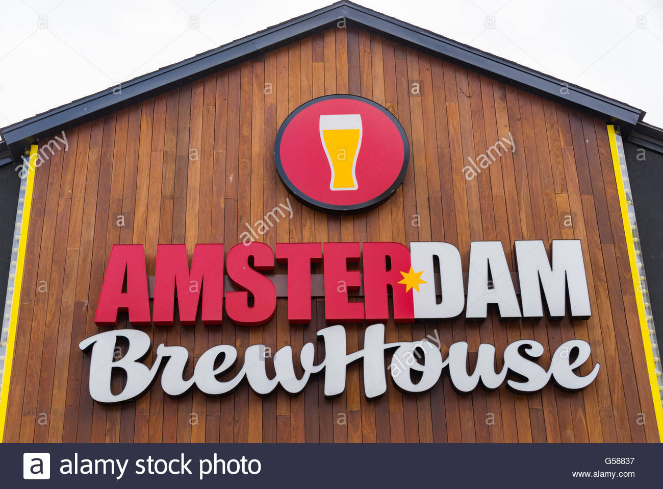 Amsterdam Brew House on the Lake, vintage wooden sign. The Brewery is popular for its beer and outdoor's restaurant - Stock Image