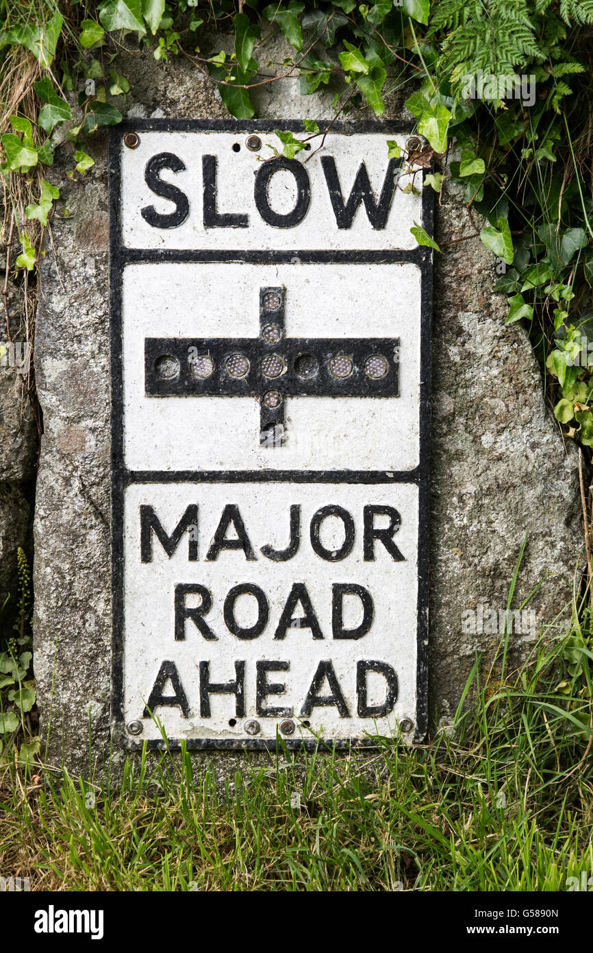 Old fashioned sign warning of major road junction ahead, St Keverne, Lizard peninsula, Cornwall, England, UK - Stock Image