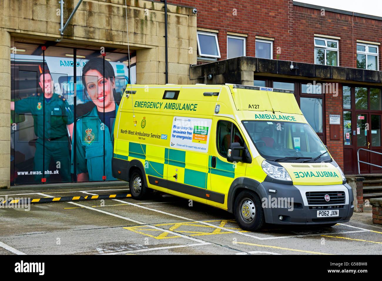 Ambulance parked outside fire station, England UK - Stock Image