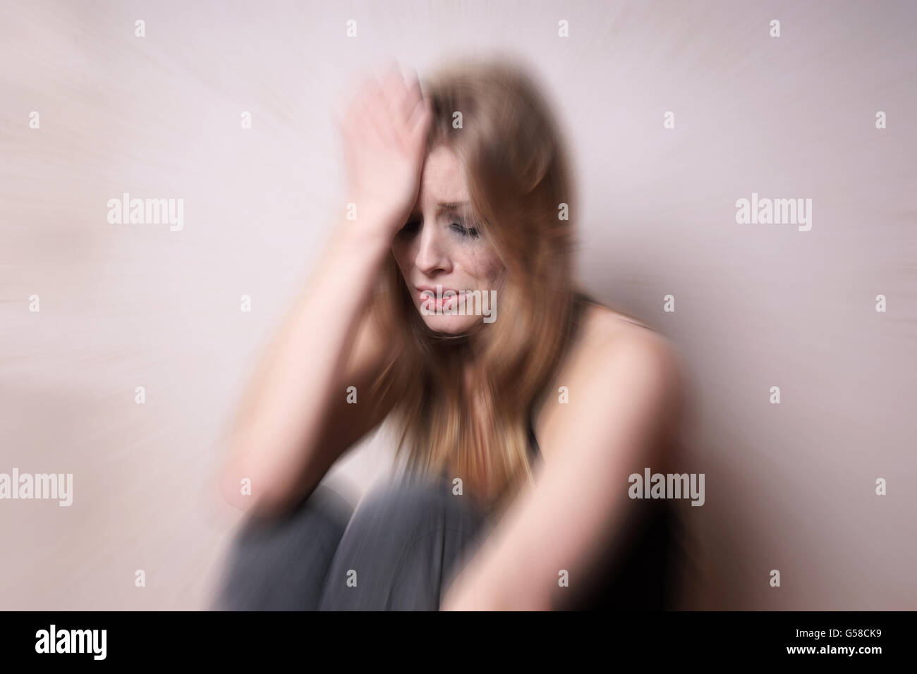 sad depressed young woman with tear-stained face - Stock Image