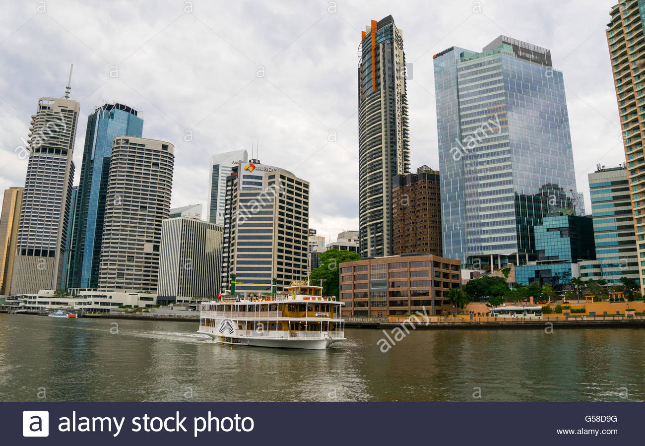 Kookaburra River Queen paddle steamer Brisbane river with modern building in the background - Stock Image