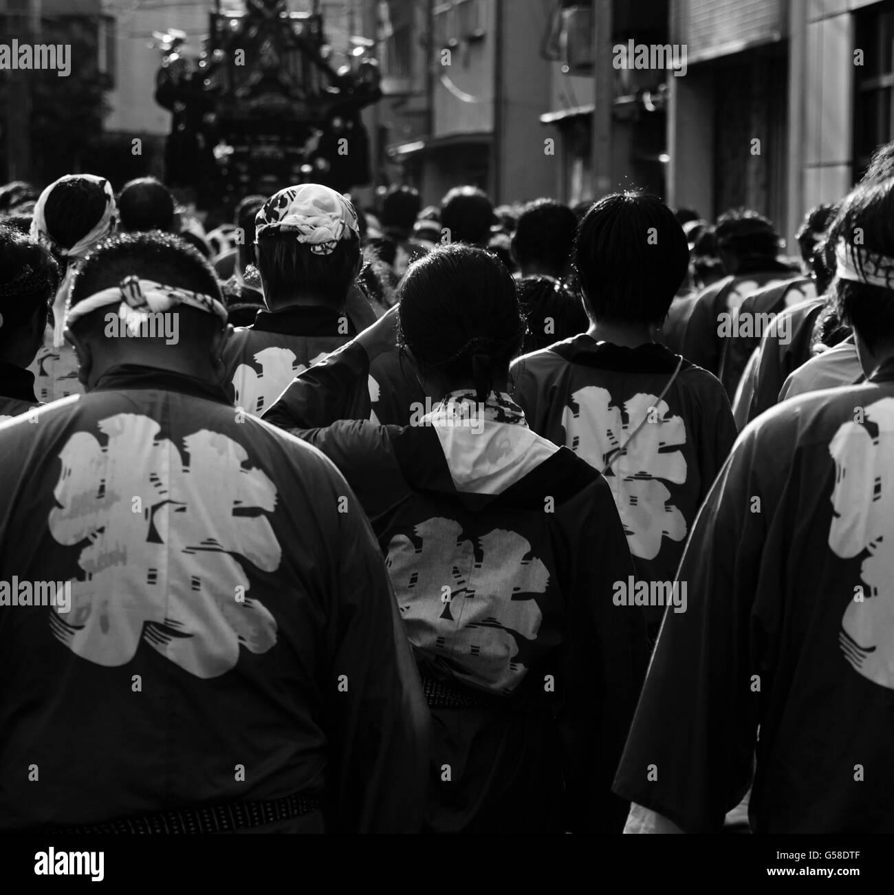 Participants walk after a portable shrine at the Tokyo Fukugawa Hachiman festival - Stock Image