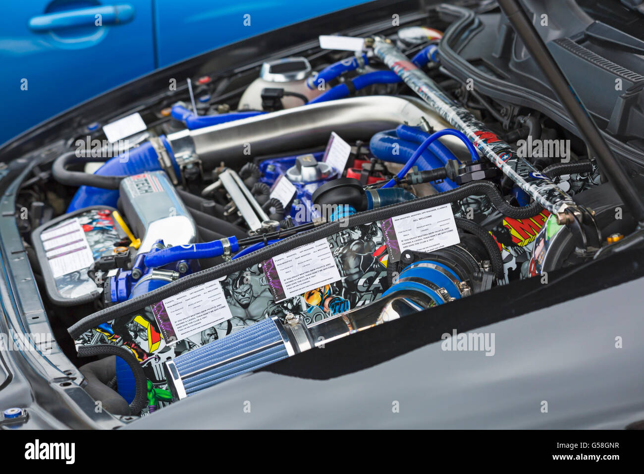 Bonnet of car raised to show engine with information leaflets on ...
