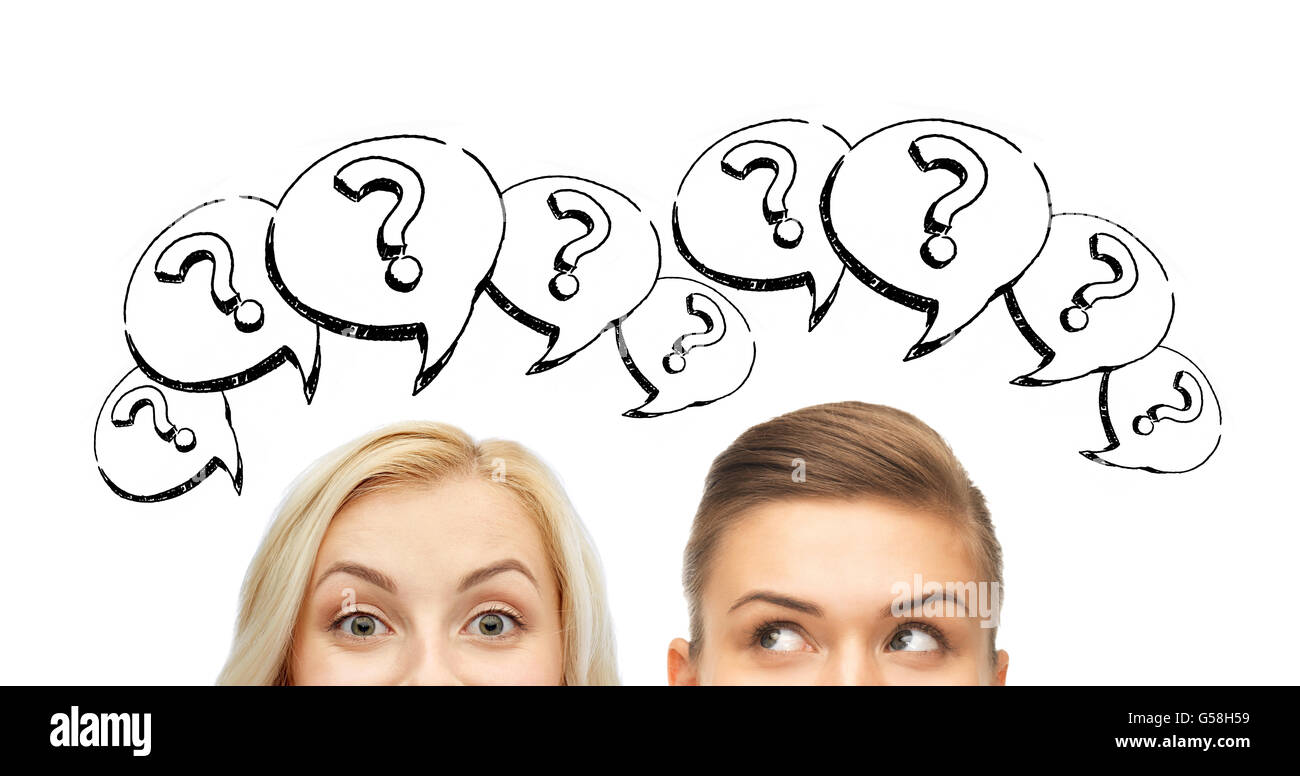 happy young women faces with question marks Stock Photo