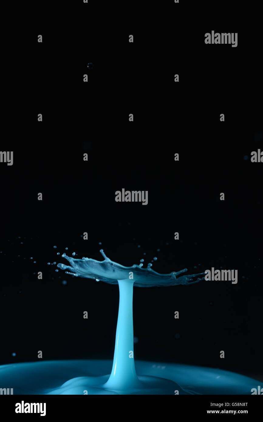 splash from collision of water drops captured with high speed photography - Stock Image