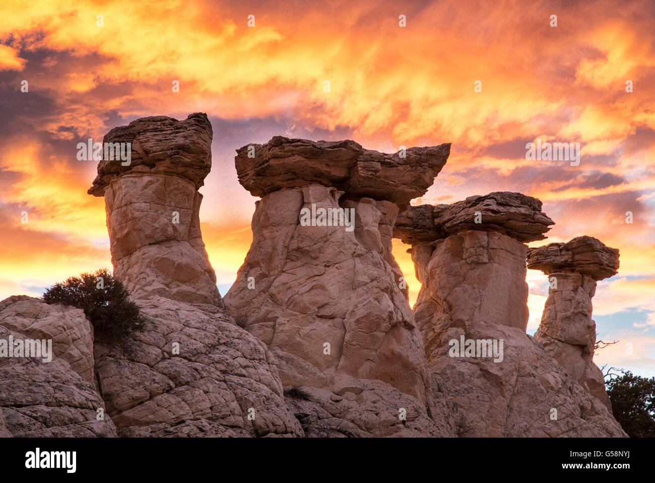 Toadstool shaped rimrocks called hoodoos at sunrise in the Grand Staircase Escalante National Monument near Kanab, Stock Photo