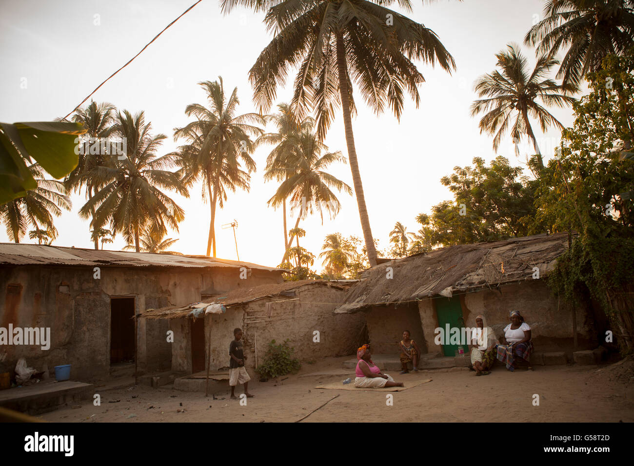 The sun sets over a suburban neighborhood in Nampula, Mozambique. - Stock Image