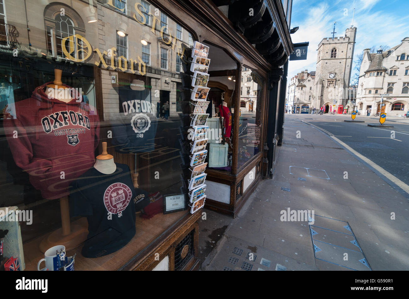 View of the Oxford High Street shop and Carfax Tower, Oxford, United Kingdom - Stock Image