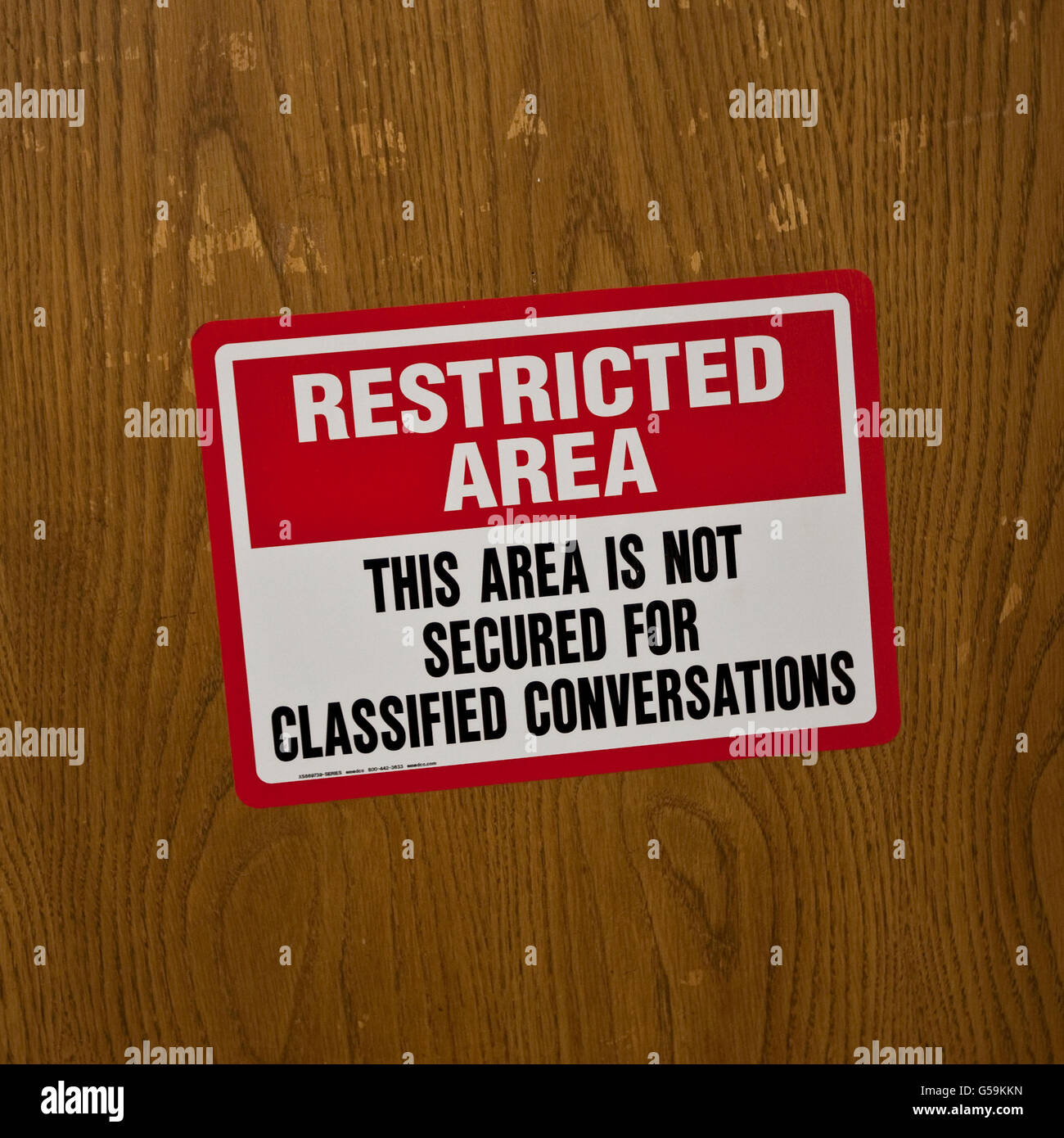 Sign: 'Restricted area. The area is not secured for classified conversations' at FBI National Academy in - Stock Image