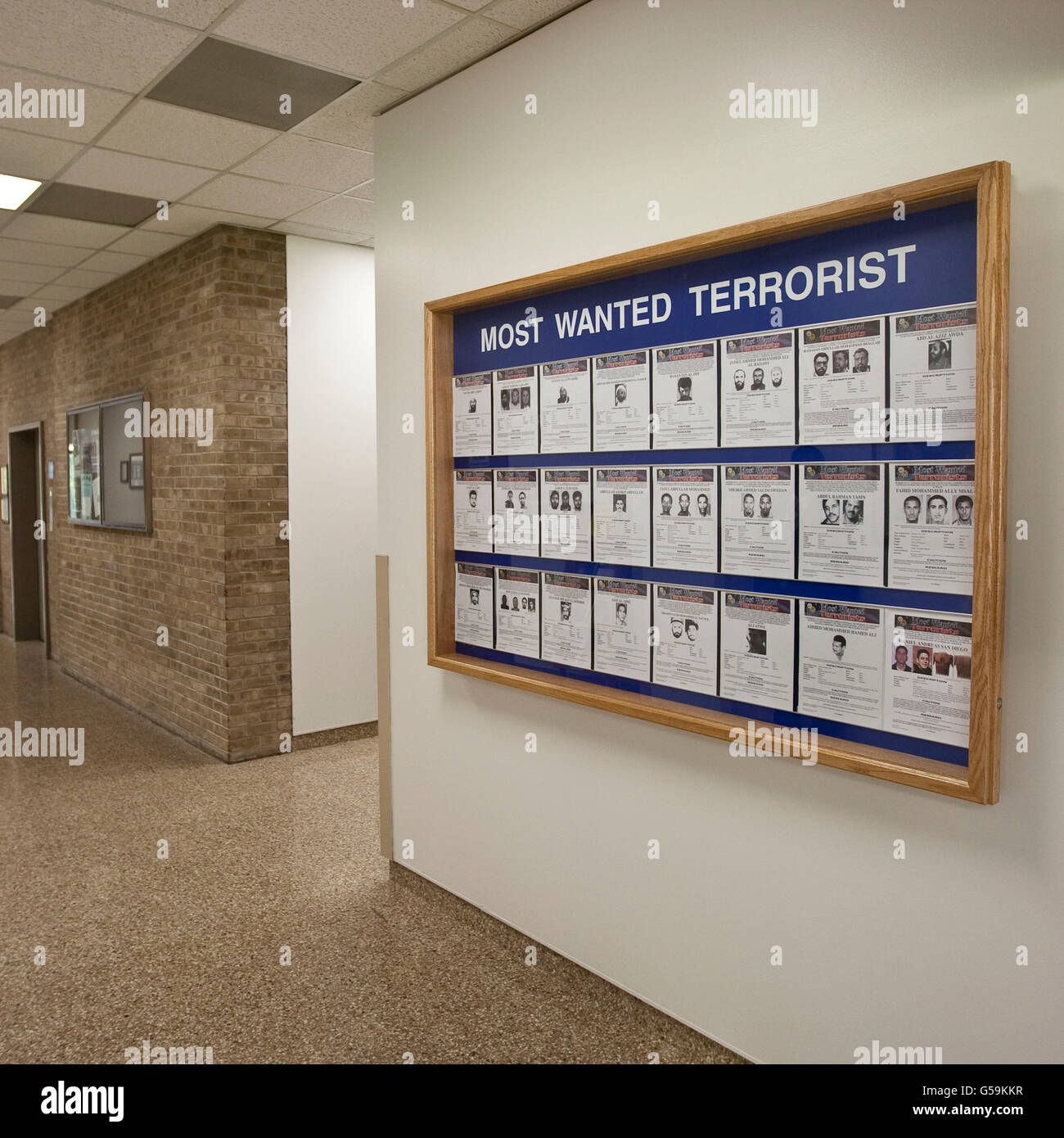 Display listing the FBI's most wanted terrorists on a wall