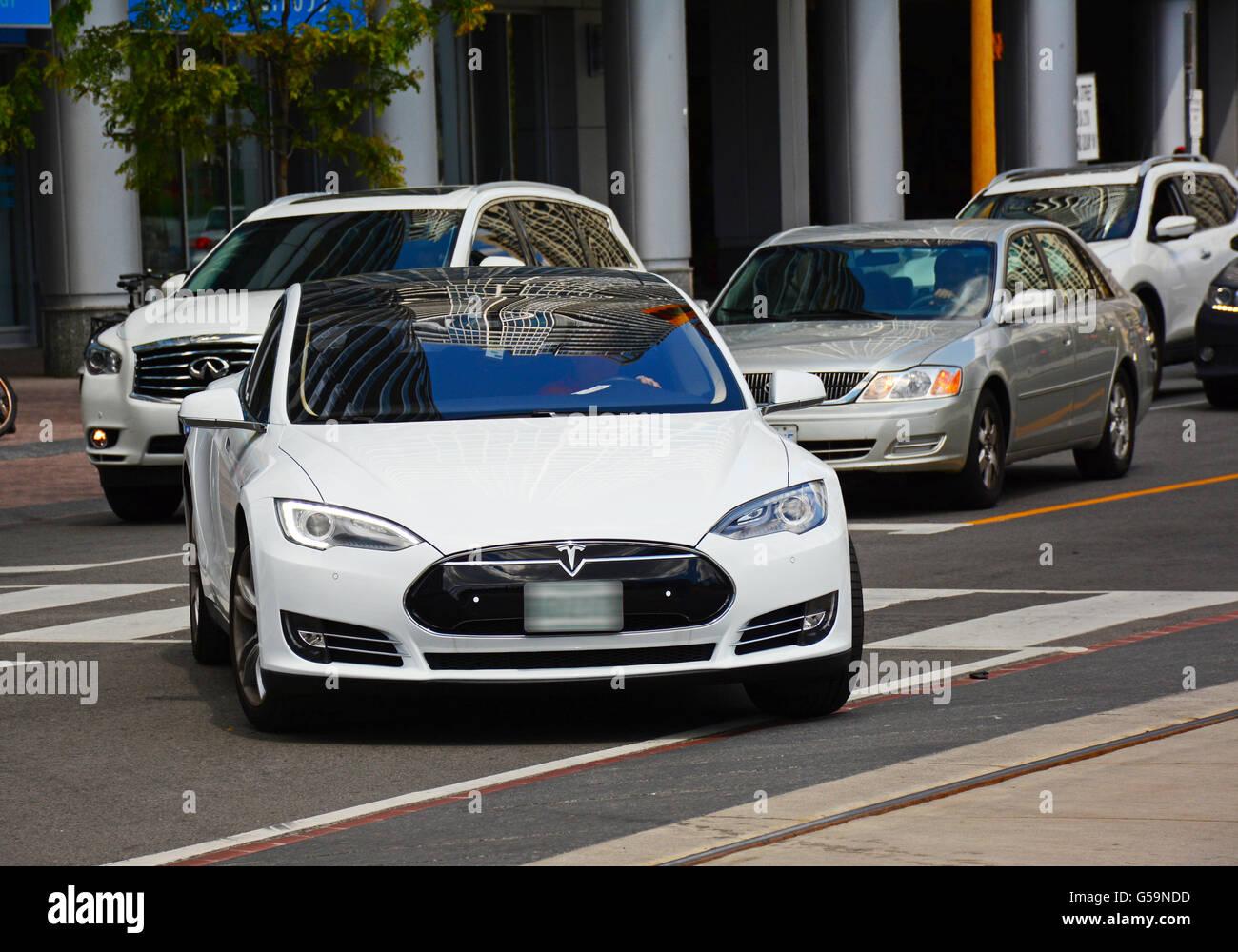 Tesla, Electric car in Toronto streets, Canada - Stock Image
