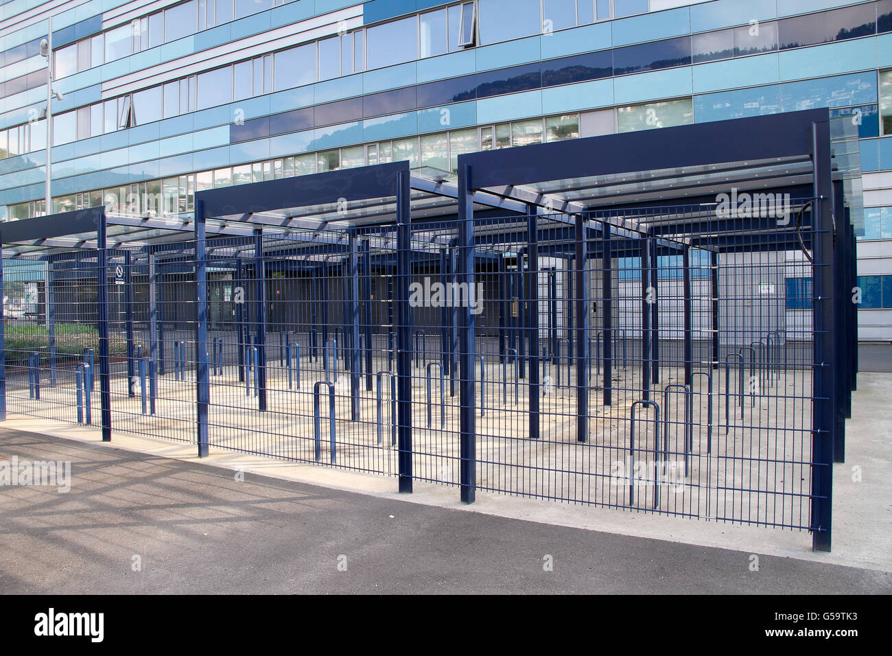 Bike parking outside ADO Arena / Amalie Skram school in Bergen - Stock Image