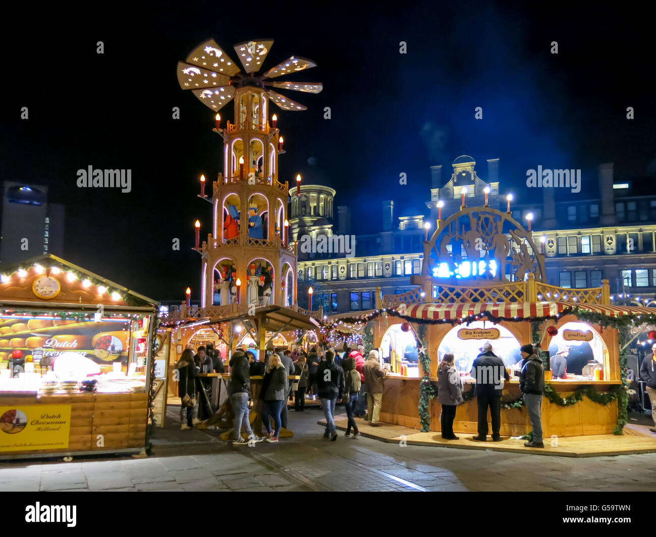 Night scene with people on Christmas Market in Manchester, England, United Kingdom Stock Photo