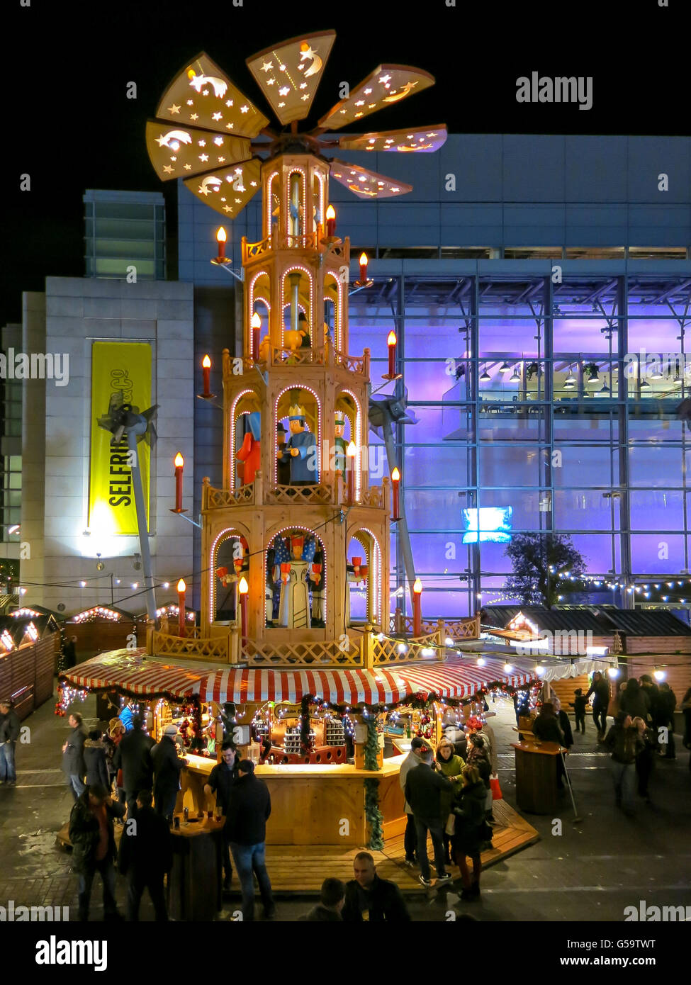Night scene with people on Christmas Market in Manchester, England, United Kingdom - Stock Image