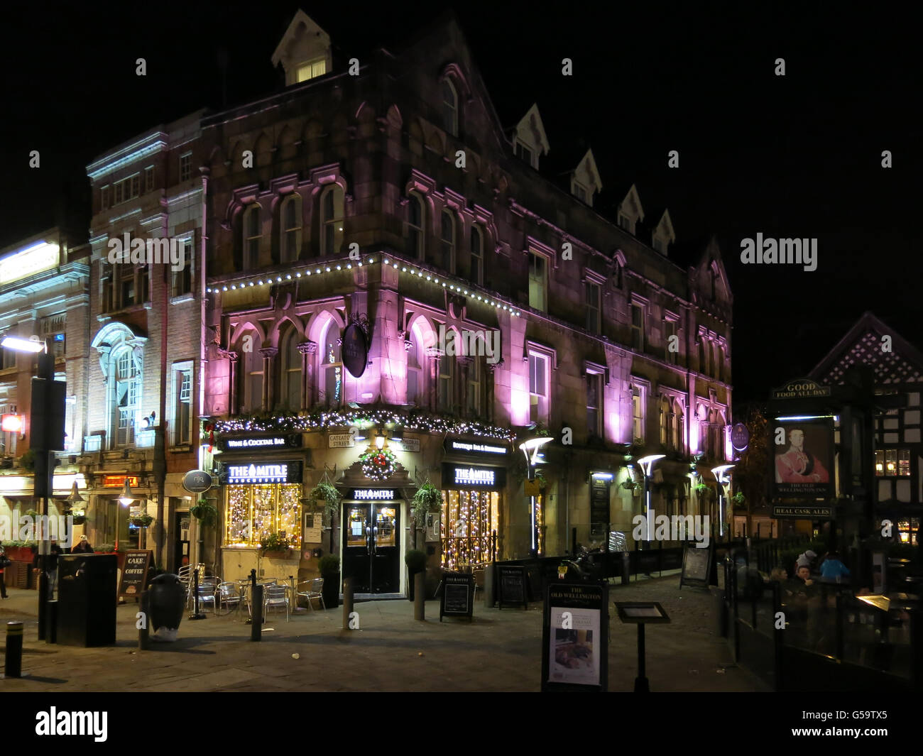 The Mitre Bar at Shambles Square by night in the city centre of Manchester, England, UK Stock Photo