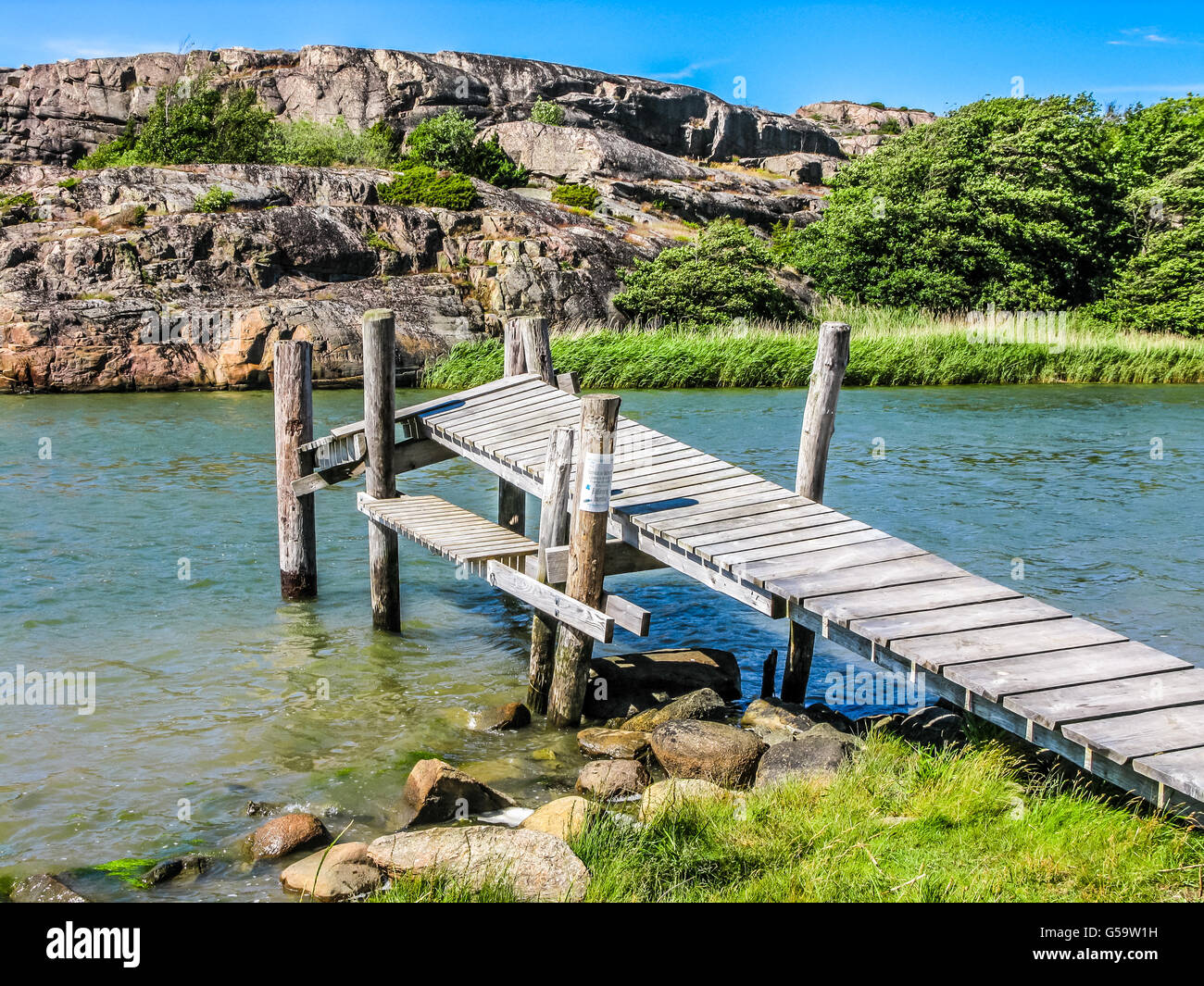 Old jetty in Bohuslan, Gotaland, at the southwest coast of Sweden, Scandinavia - Stock Image