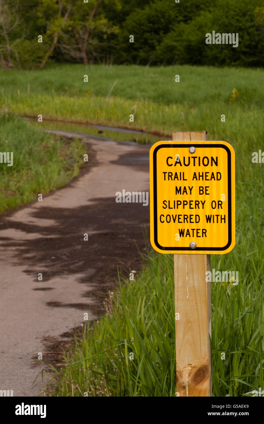 Obvious Caution Sign at Trail Head - Stock Image