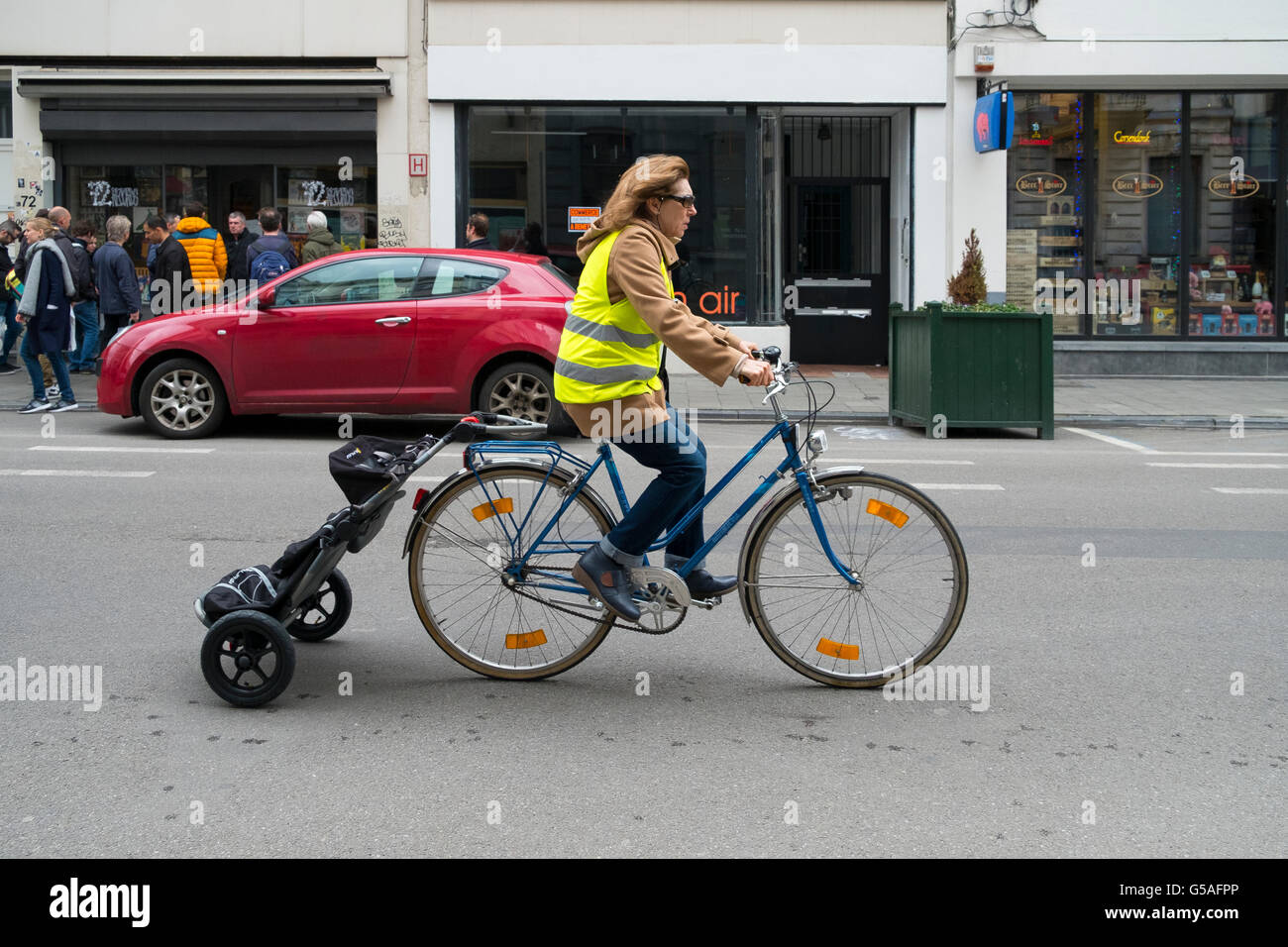 woman cycling bicycle shopping caddy attached - Stock Image