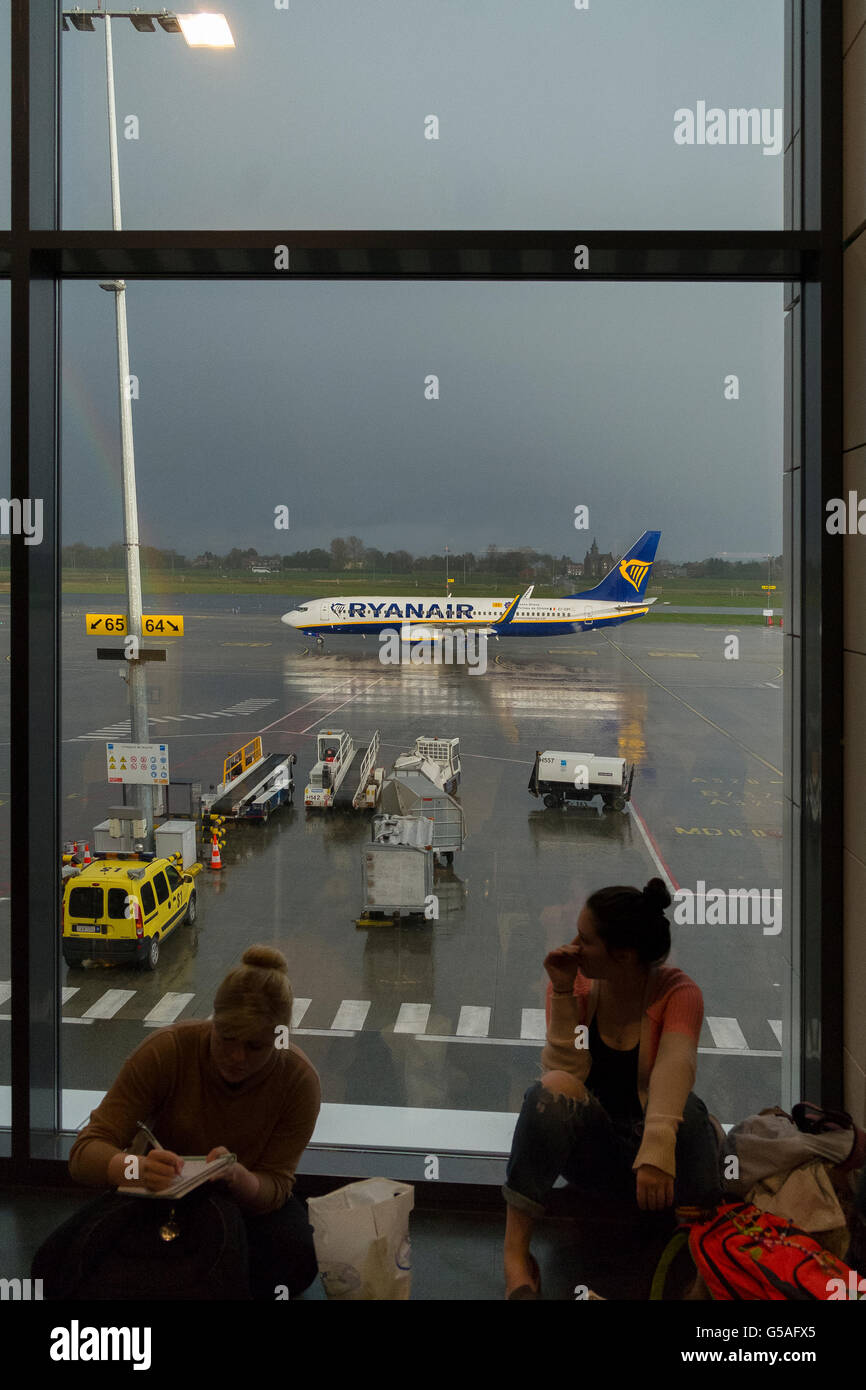 ryanair aircraft plane on runway outside terminal - Stock Image