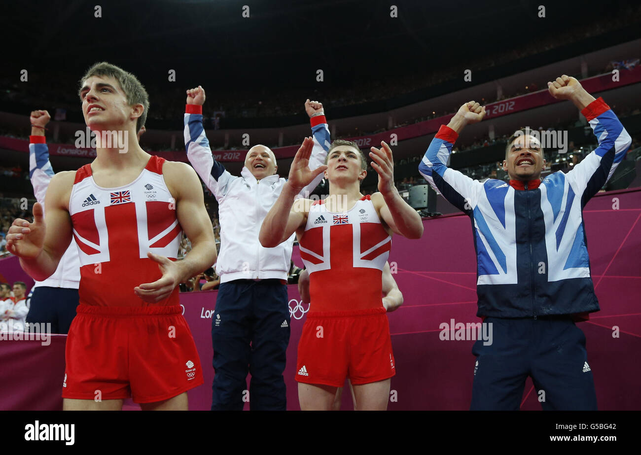 ADDS UPDATED MEDAL RESULTS- Team Britain celebrates winning the silver medal at the Artistic Gymnastic men's team Stock Photo
