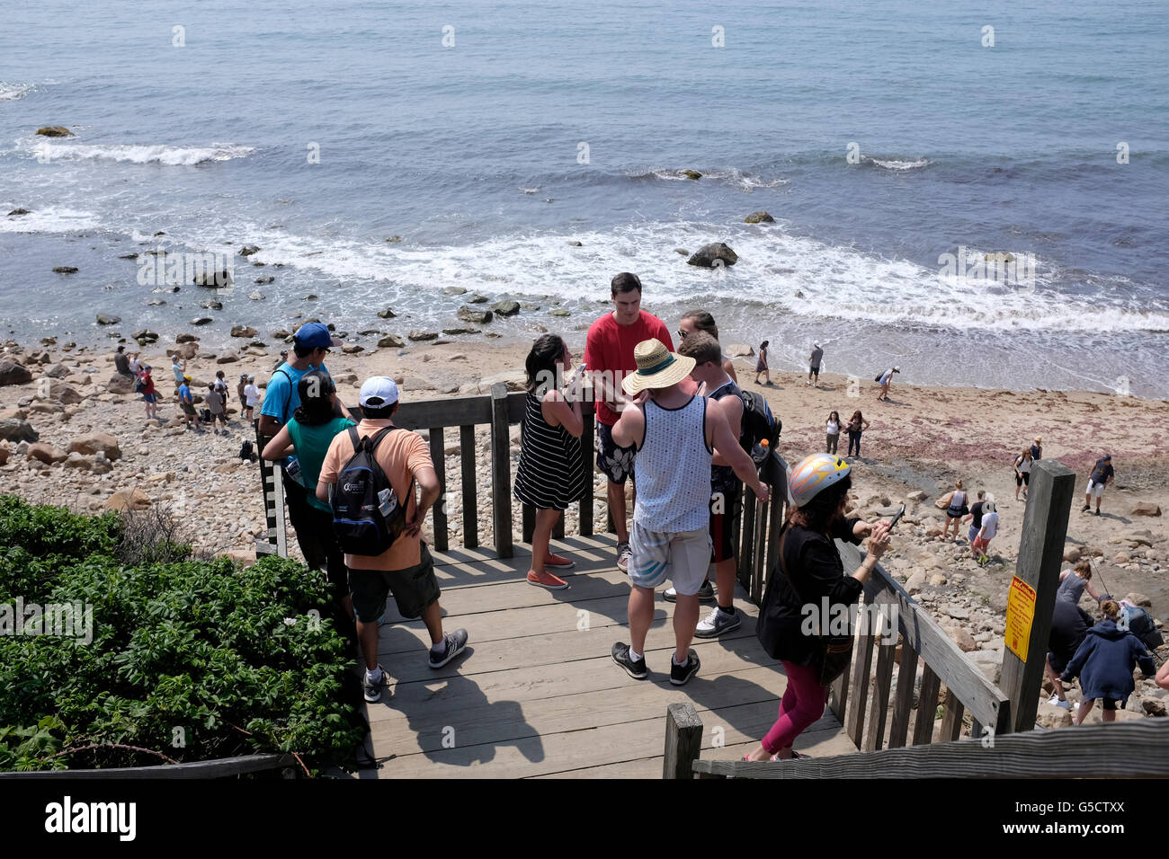 Tourists at the beach near Mohegan's Bluffs, Block Island, Rhode Island - Stock Image