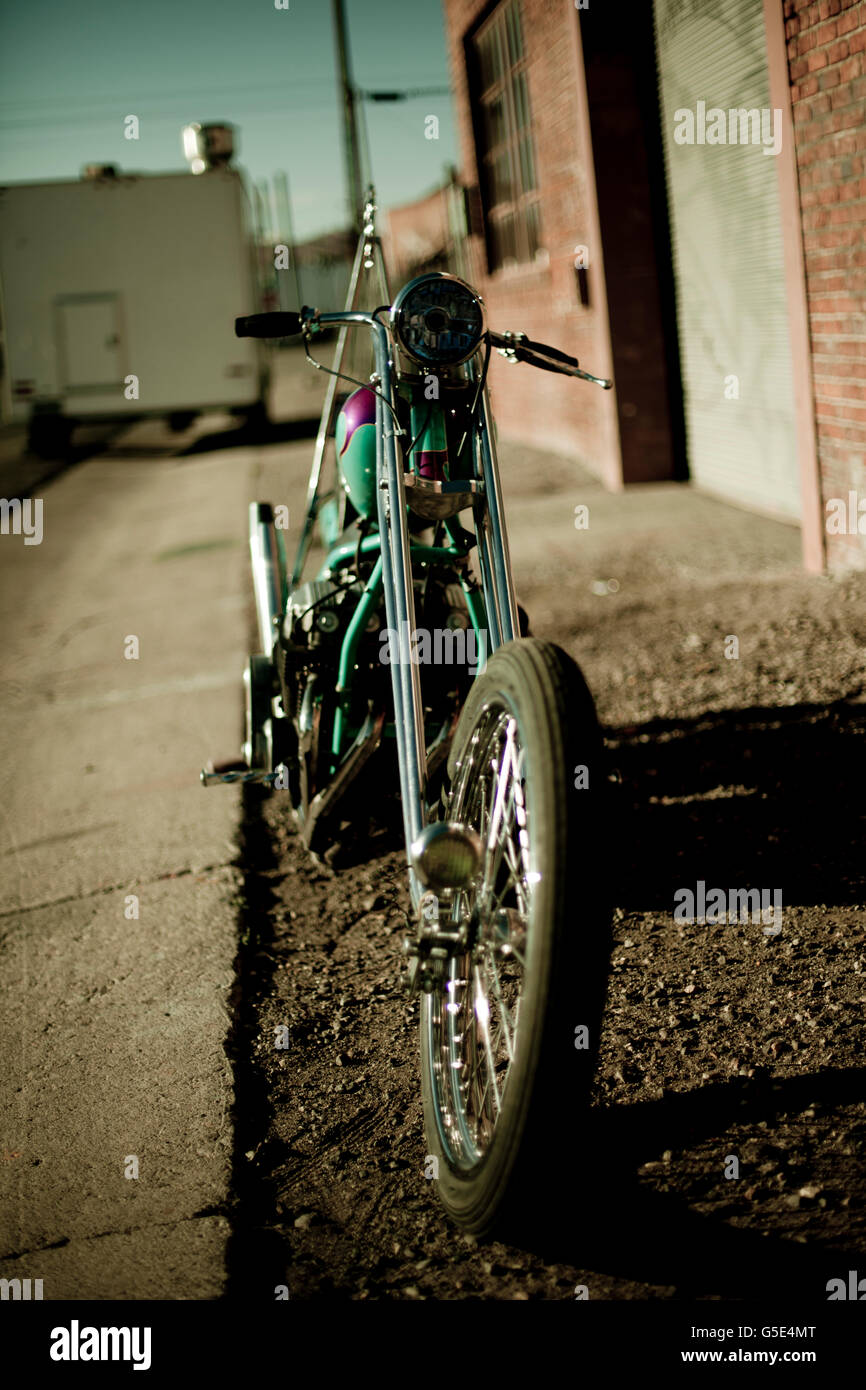 Chopper motorcycle front wheel and vintage light - Stock Image