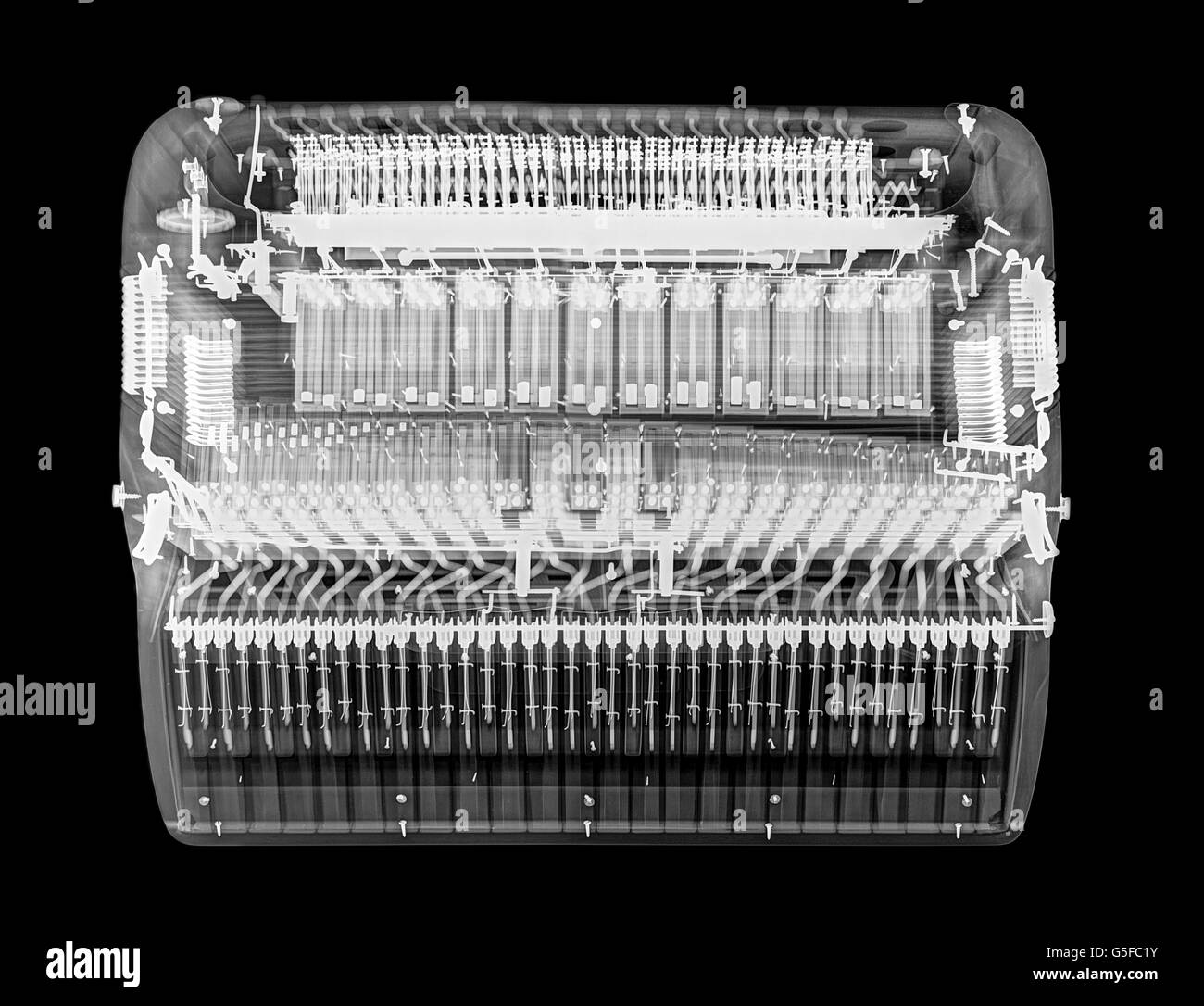 X-ray of an Accordion on black background - Stock Image
