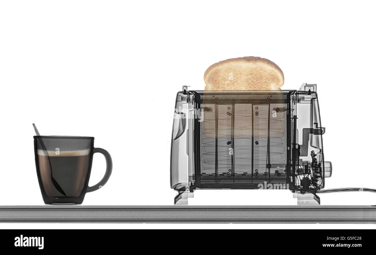 Toaster with toast and a cup of coffee under x-ray - Stock Image