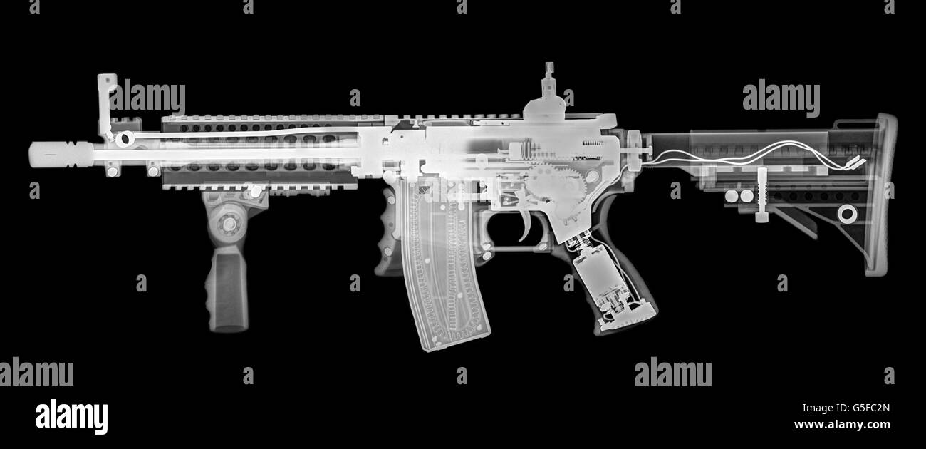 Toy imitation m-16 assault rifle under x-ray - Stock Image