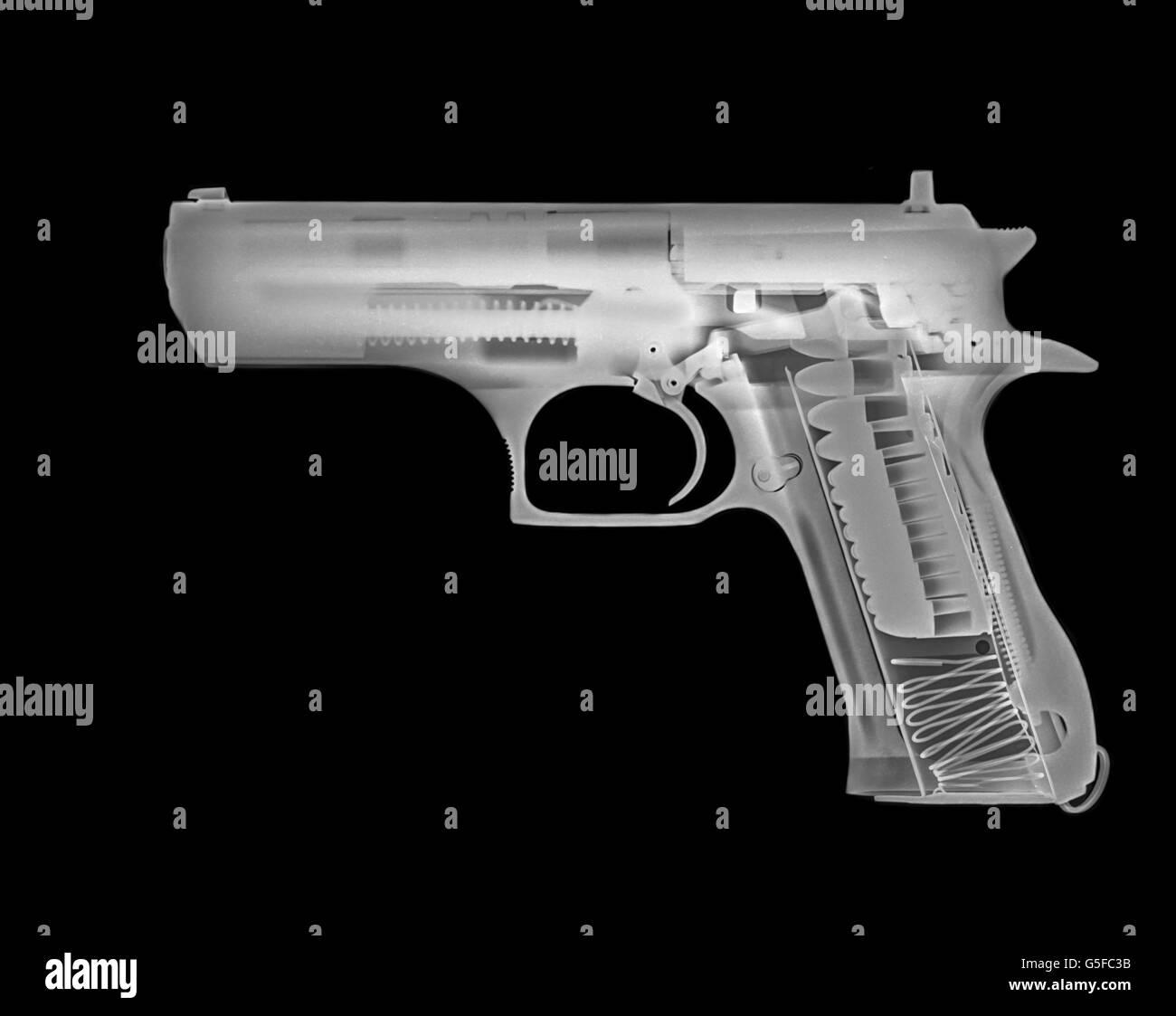 Handgun under x-ray - Stock Image