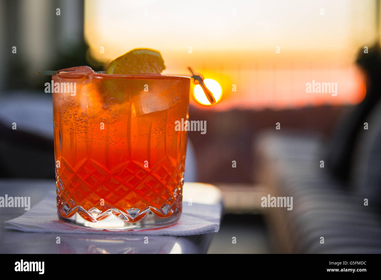 cold drink sunset - Stock Image