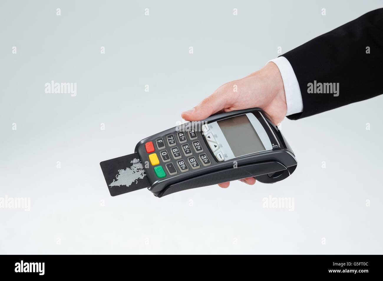 Hand of businessman in suit holding bank terminal with credit card over white background Stock Photo