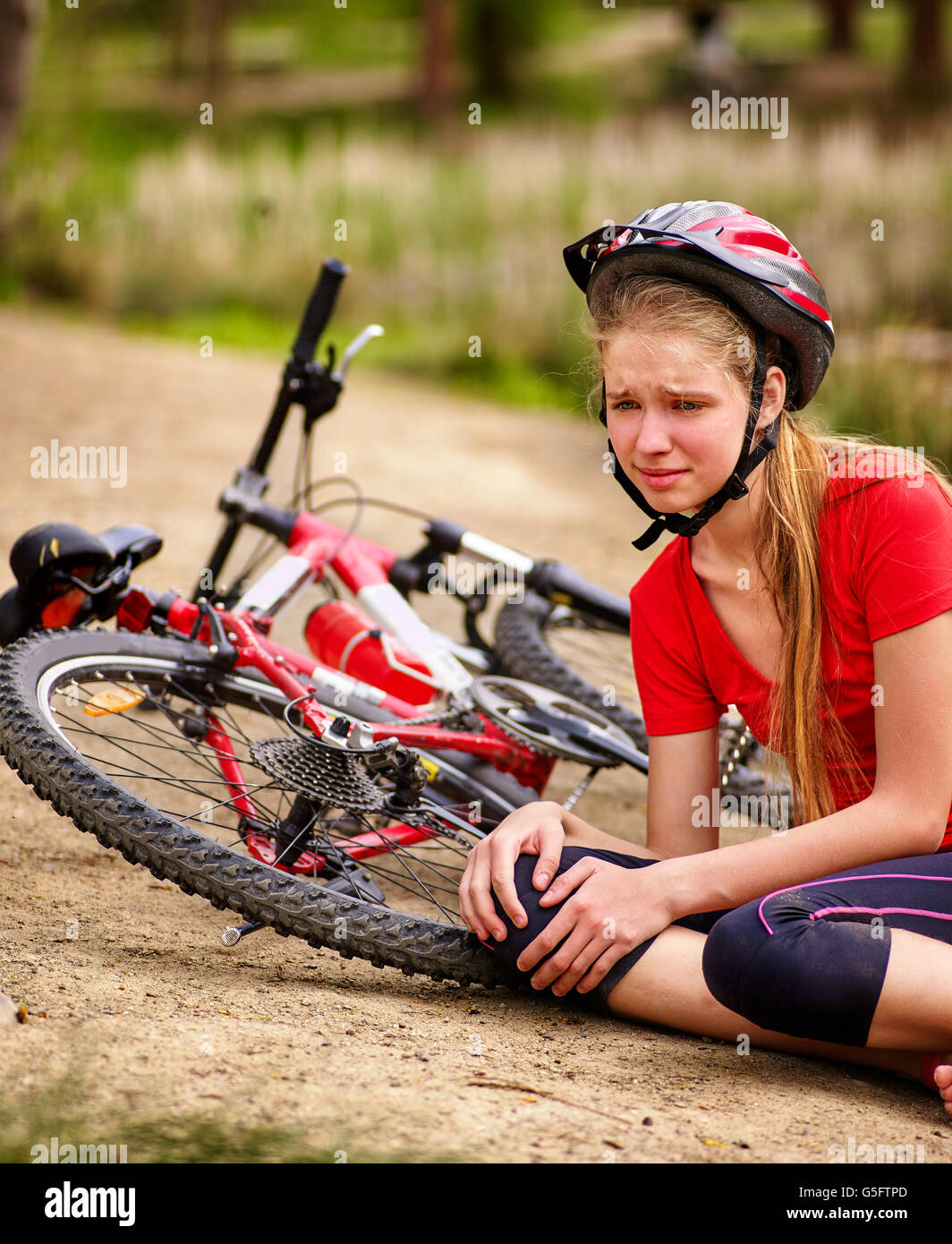 Bikes cycling girl wearing helmet. Kid fell off bike Stock Photo ... 2ae9b896d