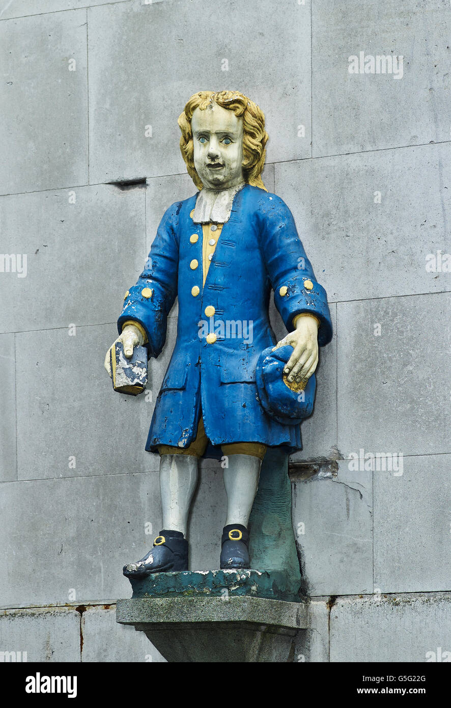 St Andrew's Holborn: blue coat orphan boy  wearing blue coat and holding Bible - Stock Image