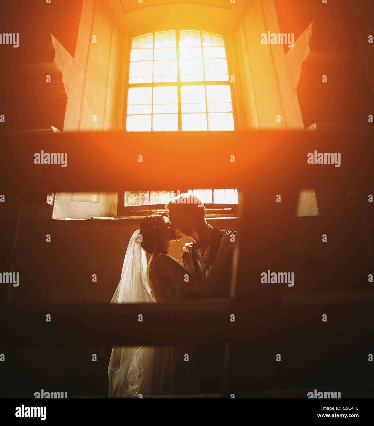 bride and groom on the background of a window. Stock Photo