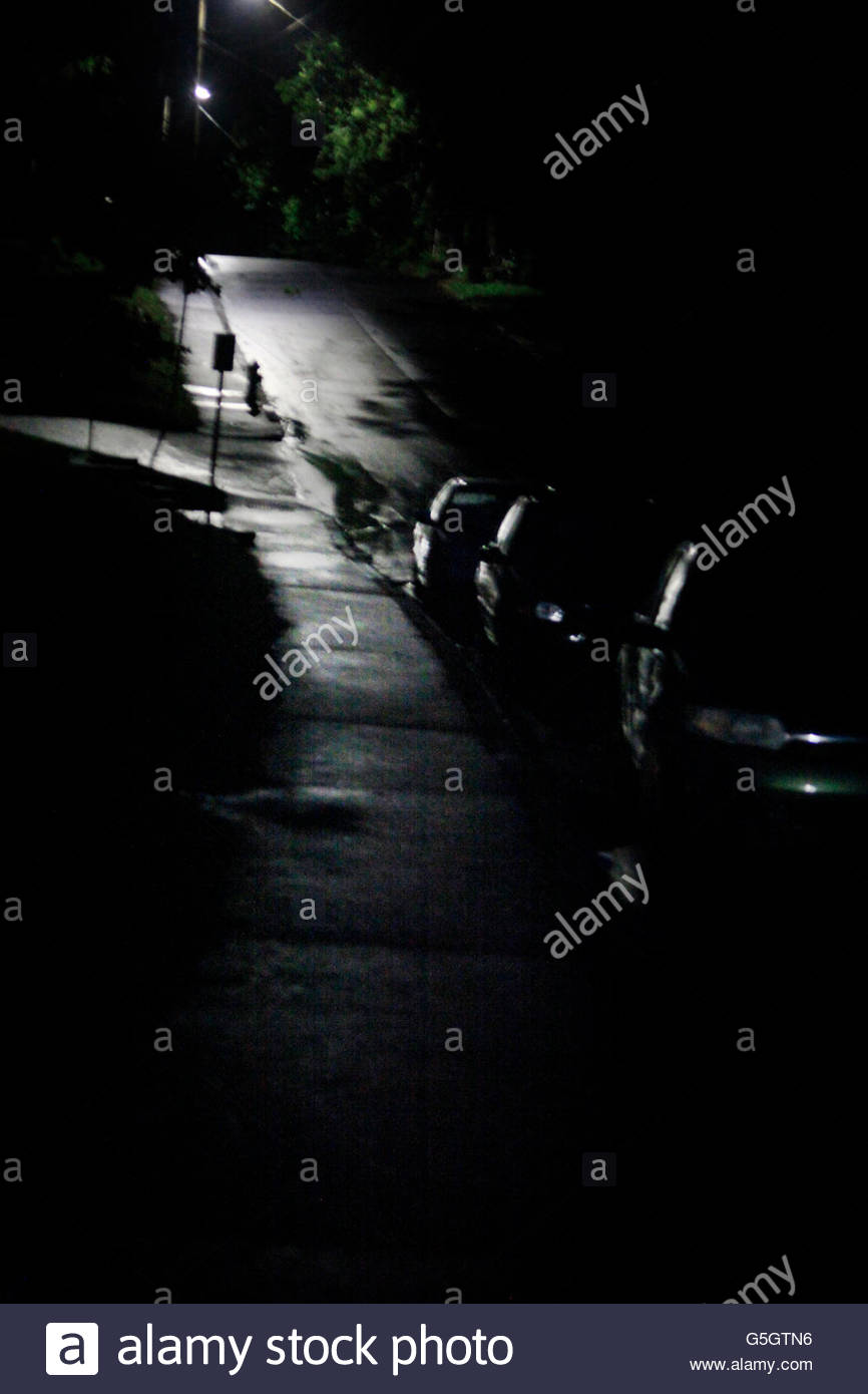 Nightime street after a rainfall - Stock Image