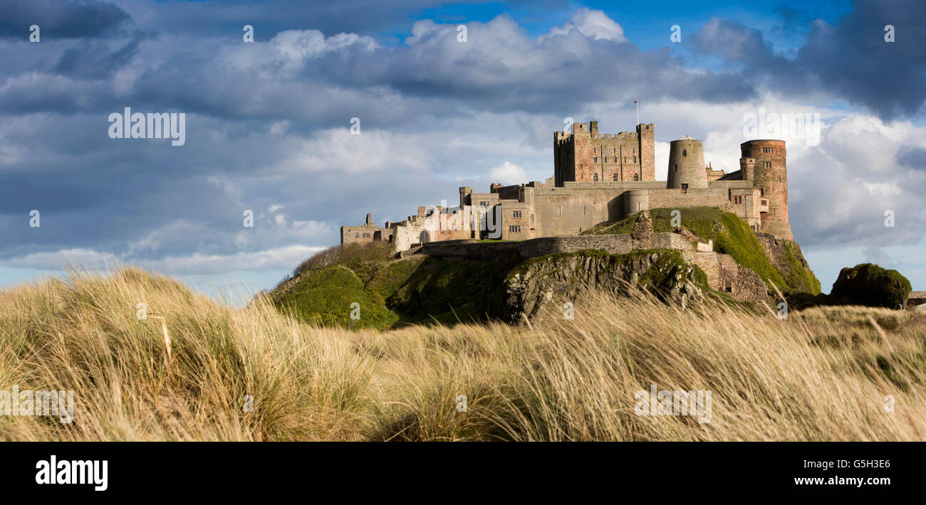 UK, England Northumberland, Bamburgh Castle, from the Wynding Beach, late afternoon, panoramic Stock Photo
