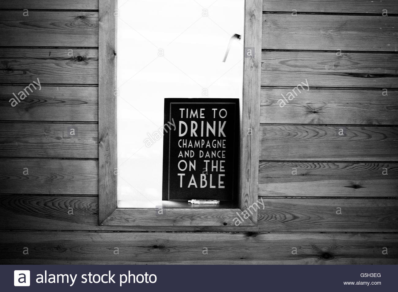 Comical sign inside window - Stock Image