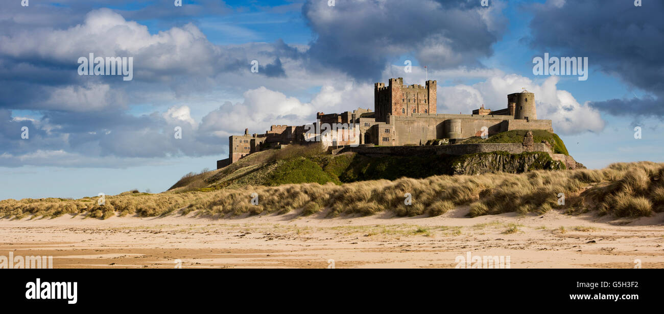 UK, England Northumberland, Bamburgh Castle, from the Wynding Beach, late afternoon, panoramic - Stock Image