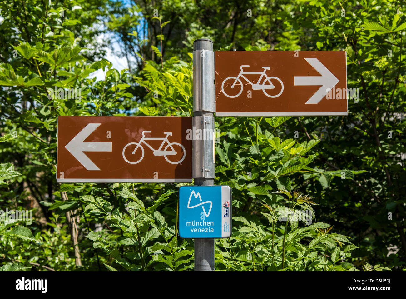Cycle lane sign showing the Munich-Venice cycle route, Bruneck - Brunico, South Tyrol, Italy - Stock Image