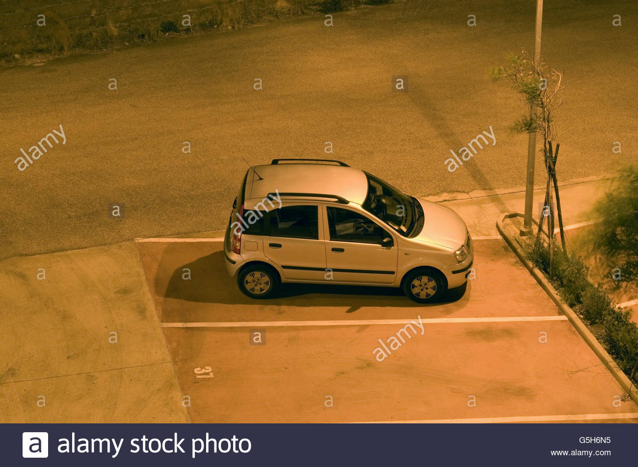 parked car at night - Stock Image
