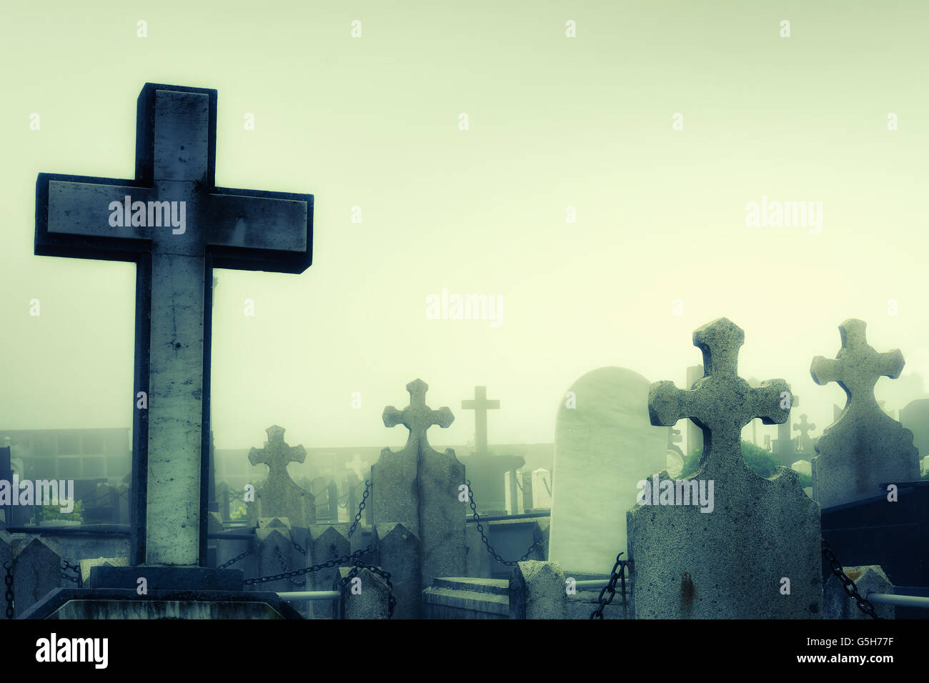 cementery with tombstones and crosses - Stock Image