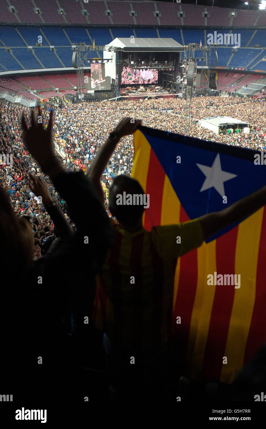 A bruce springsteen fan waves the Estelada flag, national flag of catalonia at the Bruce Springsteen concert at - Stock Image