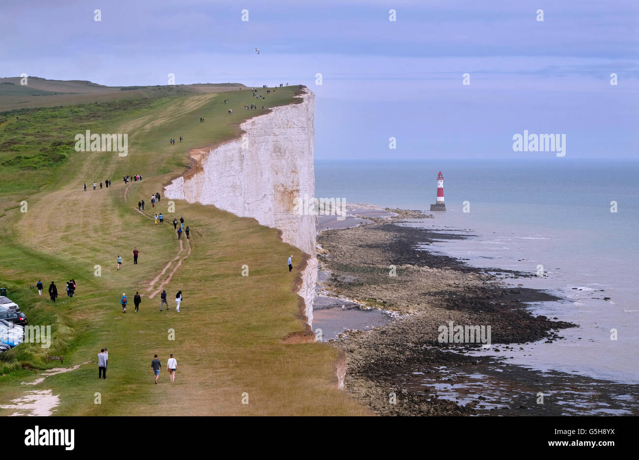 People on the South Downs Way footpath near Beachy Head. Eastbourne, Sussex, England. - Stock Image